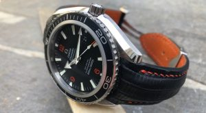 Omega Planet Ocean on SuperMatte carbon Black Teju Lizard