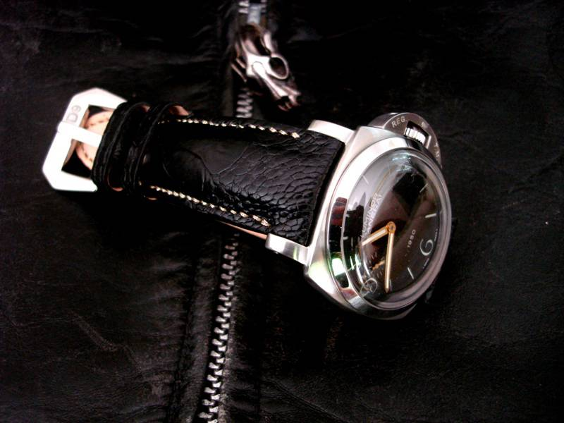 PAM127 on Black Satin Ostrich Leg skin strap with Integrated Fit and Metallic Gold stitching
